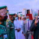 Buhari acknowledges salute