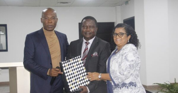 Olusiji and wife receiving a parting gift from Mr Ekeh